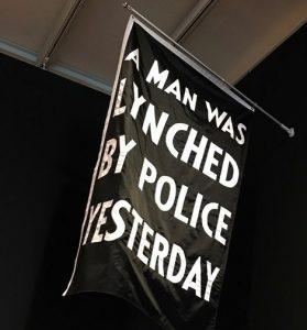 "Dread Scott - ""A Man Was Lynched"" flag"