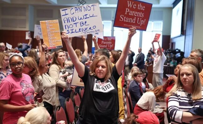 Irate parents at school board meeting